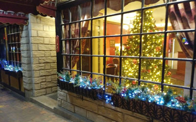 Front window of the Portland hotel Inn at St. John decorated for Christmas.