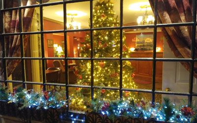 Decorated front window at Christmas of the Portland, Maine hotel Inn at St. John.