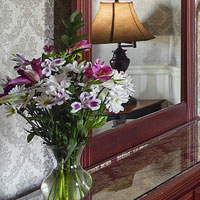 Vase of pink and purple flowers in a bedroom at the Portland, Maine hotel Inn at St. John.