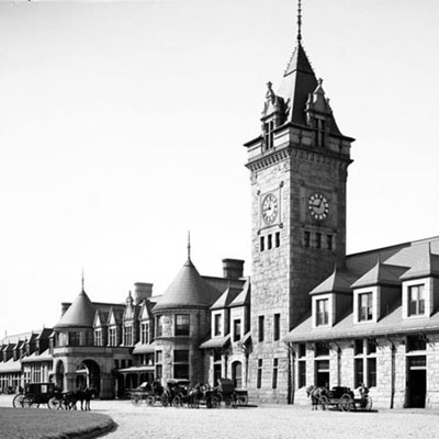 Old black and white photo of the downtown of Portland, Maine with clock tower in the middle.