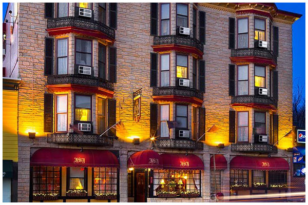 Front of the three story Inn at St. John hotel in Portland, Maine at night.