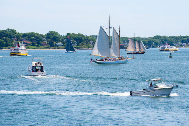 Summer view of the harbour in Portland, Maine with sailboats and motor boats on the bay.