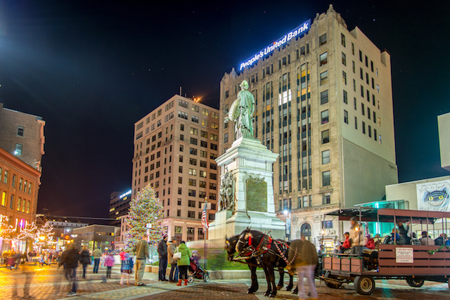 Winter view of the downtown square in Portland, Maine with horse and carriage.